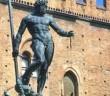 Bologna, Emilia Romagna, Italy. Piazza Maggiore (main square) Fontana del Nettuno; Palazzo del Re Enzo (King Renzo's Palace