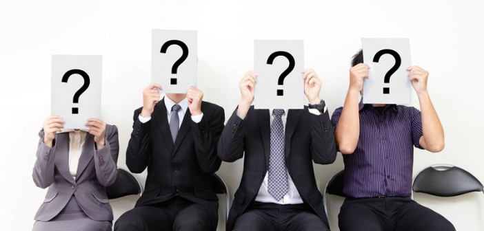 Human resource concept, Young businessman holding white billboard with a question mark on it and waiting for job interview, , asian people